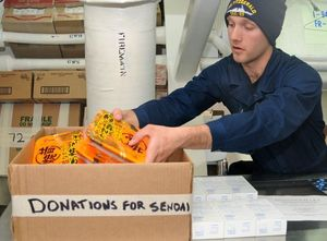 0331 US naval personnel pack donations for Japan.jpg